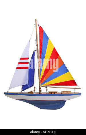 toy sail boat cut out on white background - Stock Photo