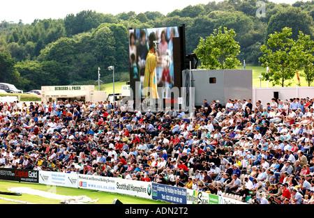 Spectators watching a Twenty 20 cricket match featuring Hmapshire - Stock Photo