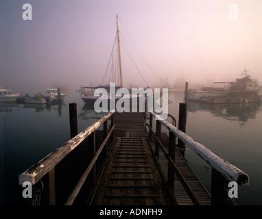 Misty morning over Yarmouth harbour, Yarmouth, Isle of Wight, England, UK - Stock Photo