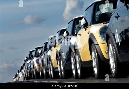 Long lines of brand new BMW Mini and Mini Cooper cars await export at Wallenius Wilhelmsen Shippers at Southampton - Stock Photo