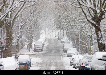 Cars parked in a snow covered Hampstead street North London England United Kingdom - Stock Photo