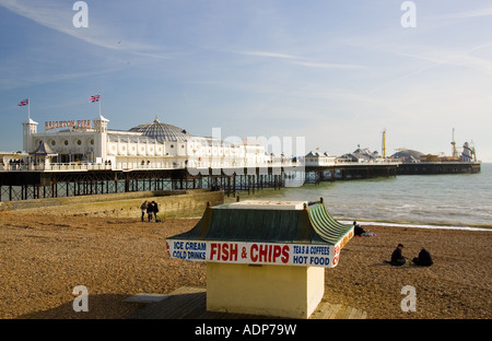Fish and chip shop on beach by Brighton Pier on the South Coast of England United Kingdom - Stock Photo