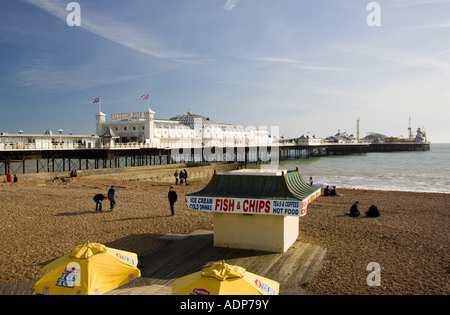 Fish and chip shop on beach by Brighton Pier England United Kingdom - Stock Photo