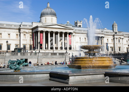 Fountains in front of National Gallery in Trafalgar Square London United Kingdom - Stock Photo