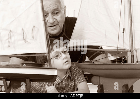 Grandfather Showing Grandson his Boat Models - Stock Photo