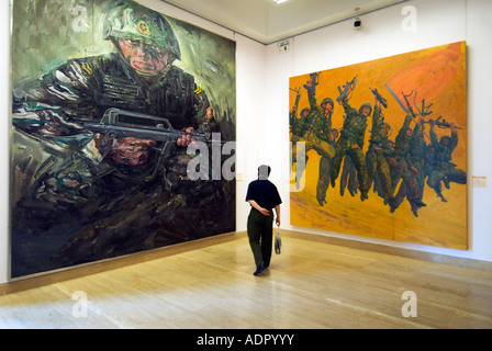 Modern paintings depicting the Peoples Liberation Army PLA in National Art Museum  of China in Beijing 2007 - Stock Photo