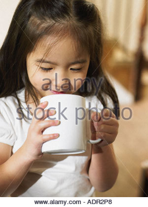 Little girl holding a cup - Stock Photo