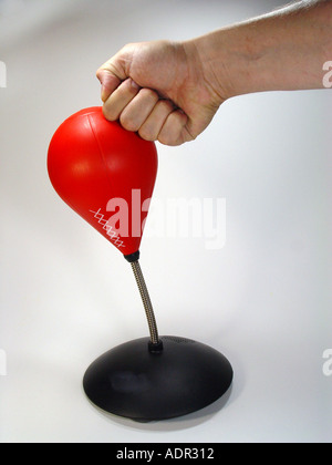 Punching ball as symbol for aggression dismantling force Mobbing etc