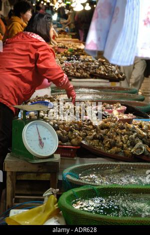 Shellfish for sale at seafood market Incheon Gyeonggi Do South Korea - Stock Photo