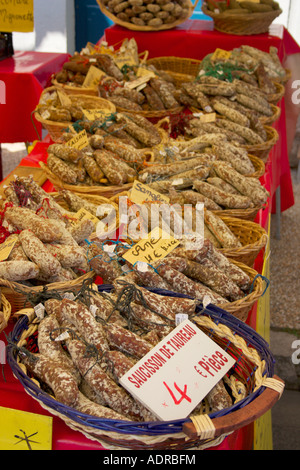 Saucisson de taureau  for sale on a typical French market in the Herault, Languedoc Roussillon region of the south - Stock Photo