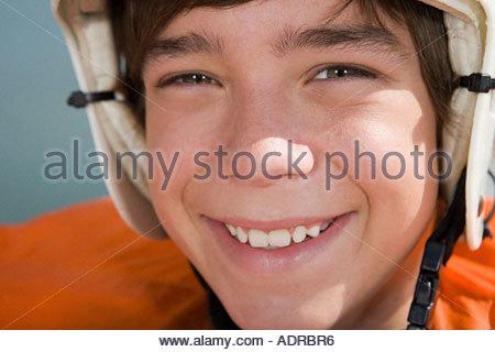 Boy wearing helmet for canoeing - Stock Photo