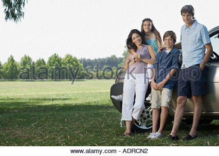 Family standing in a field - Stock Photo