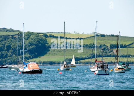 Boats at moorings in Carrick Roads close to St Just in Roseland - Stock Photo