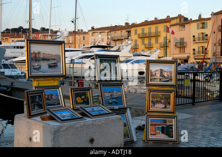 St Tropez waterfront street scene with shops and pavement bar with ...