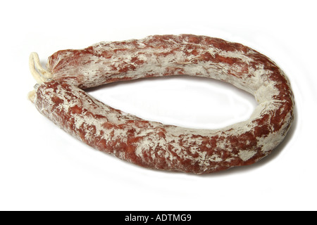 French dry cured sausage isolated on a white studio background. - Stock Photo