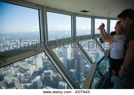 Tourists in the sky pod the world s highest observation deck on the CN Tower in Toronto Ontario Canada Stock Photo