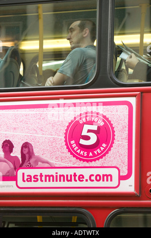 An advert on a london Bus persuading the public to take 5 holidays a year not very sustainable if they are all flying - Stock Photo