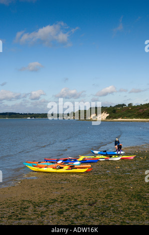 Sea kayaks on a beach - Stock Photo