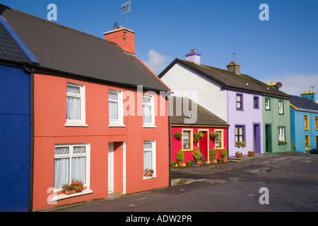 Row of colourful houses in main street in village on Ring of Beara route on Beara peninsula Eyeries County Cork - Stock Photo