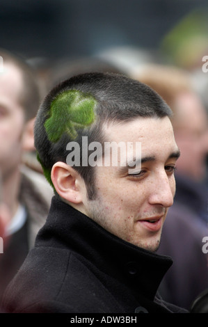 Irish man at Cheltenham Gold Cup horse Race with a picture of a four leaf clover on the side of his head