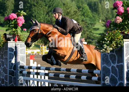 A horse get over the obstacle at the jumping event of the International Bromont at the Bromont Olympic Horse Park - Stock Photo