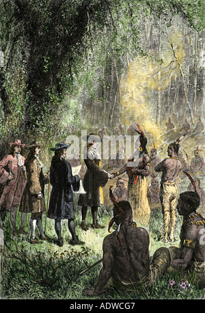Native Americans concluding a treaty with William Penn 1680s. Hand-colored woodcut - Stock Photo