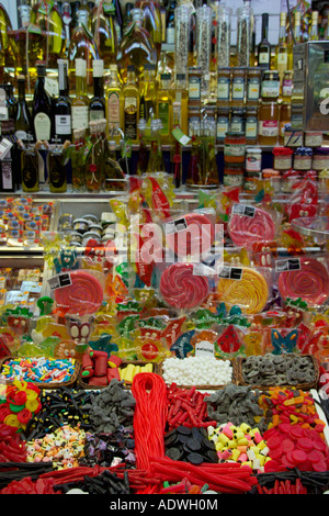 Assorted sweets and confectionary for sale at Boqueria Market La Rambla Barcelona Spain. - Stock Photo
