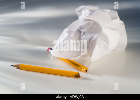 Closeup of broken pencil and crumpled paper - Stock Photo