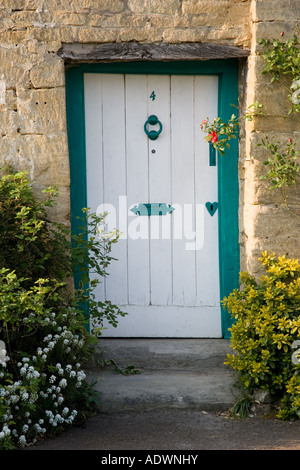 Traditional cottage front door and doorway Stanton village The Cotswolds Gloucestershire United Kingdom - Stock Photo