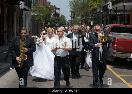 Musicians lead a wedding parade in New Orleans - Stock Photo