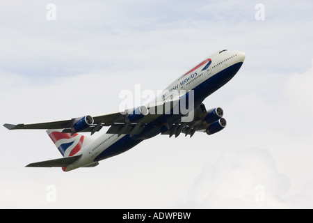 British Airways Jumbo Jet flying away from Heathrow London United Kingdom - Stock Photo