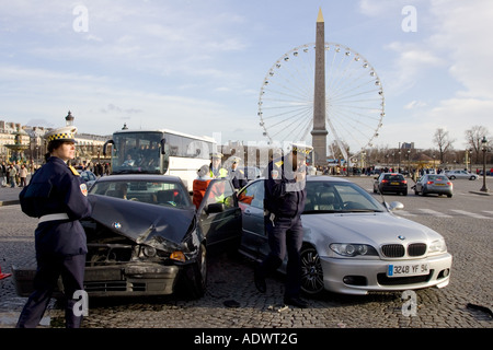 Traffic police investigate car accident between two BMW cars in Place de la Concorde Central Paris France - Stock Photo