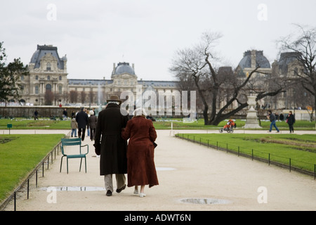 Elderly couple in Jardin des Tuileries by the Louvre Museum art gallery Central Paris France - Stock Photo