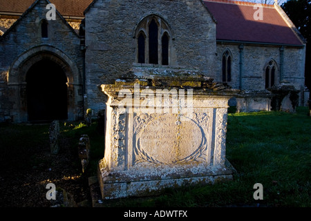 Ancient tomb in St Peter and St Paul Churchyard Broadwell The Cotswolds Oxfordshire UK - Stock Photo