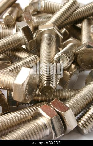 A heap of shiny silver bolts - Stock Photo