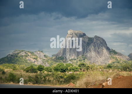 Mozambique bedrock mountains looming out against a dark black sky in the African Savannah - Stock Photo
