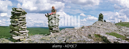 summit with stone hill, girl is sitting on a stone hill, Norway, Femund, Gutulia NP, 01.07.2002. - Stock Photo