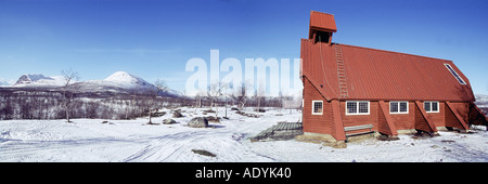 wooden church, red in winter Fjell, Sweden, Lappland, Nikkaluokta, 01.03.2004. - Stock Photo