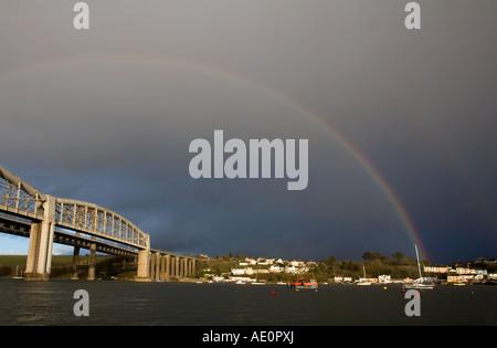 rainbow over the river tamar bridges rail bridge to foreground - Stock Photo