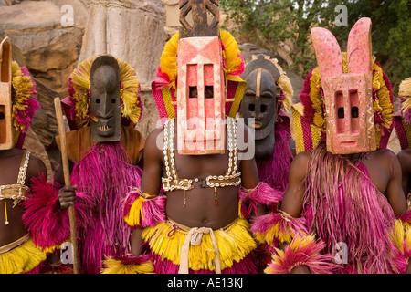 Africa West Africa Mali Dogon Country Bandiagara escarpment Masked Ceremonial Dogon Dancers near Sangha - Stock Photo