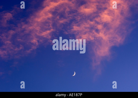 Crescent moon and clouds at sunset, Greater Sudbury, Ontario, Canada - Stock Photo