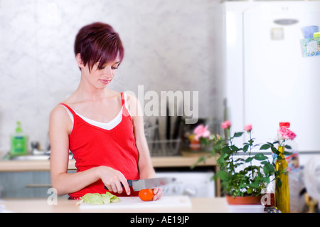young woman making salad - Stock Photo