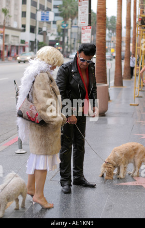 Elvis and Marilyn Monroe impersonators on the Walk of Fame at Hollywood Boulevard Los Angeles California USA - Stock Photo