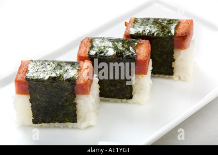 A Japanese dish on a plate consisting of three pieces of rice wraps. - Stock Photo