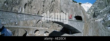 historic and modern devils bridge saint gotthard pass road swiss alpes canton of uri switzerland - Stock Photo