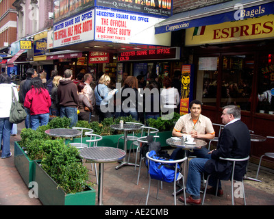 Cranbourn Street ticket booths and cafe Leicester square London England - Stock Photo