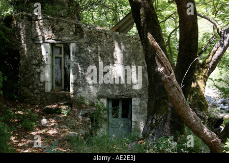 Old cottage in shade Nidri Lefkas Greece - Stock Photo