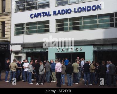 Yates pub and Capital Radio London building Leicester Square London England - Stock Photo
