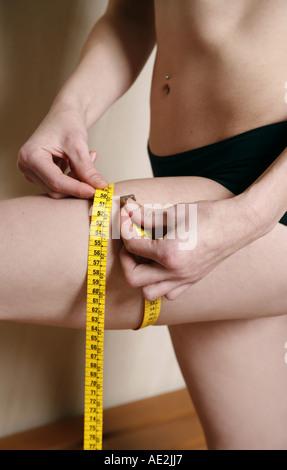Man measuring his thigh - Stock Photo