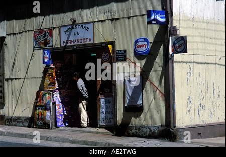 A man browses in the doorway ofa corner shop in Cerro Conception, Valparaiso, Chile South America. - Stock Photo